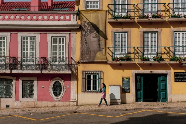 hb images - LIsboa - street with pink and yellow and woman